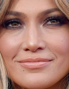 Jennifer Lopez...not bare-faced, but proof that yes, everyone ages. No matter what retouched or filtered-photos show, no one escapes lines around the eyes.