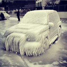 February: Severe freezing in Europe earned first place on their list showcasing this picture of a vehicle remarkably covered in ice