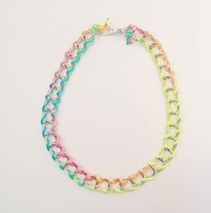 Add a pop of neon around your neck.
