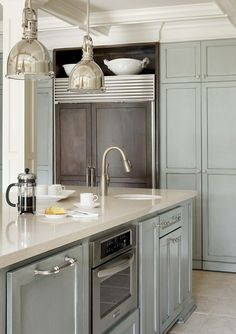 Soft grey cabinets & white countertops - the addition of cocoa cabinet is a lovely contrast to the cool grey