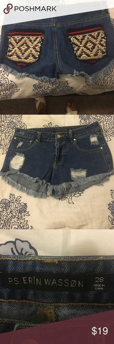Denim cut off shorts with crocheted pockets. P.S. Erin Wasson denim cut off shorts with heavy colorful crocheted back pockets leaves something when u leave! Pockets are navy,red,tan &white. ps erin wasson Shorts Jean Shorts