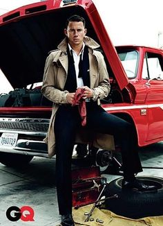 Who actually works on cars this dressed up? Coat. Suit.