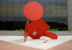 Geometric Mouse X by artist Claes Oldenburg sits in front of the Houston Public Library in downtown Houston.