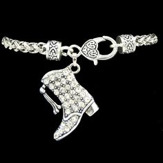 Casted jewelry is made from pewter and zinc. All of our products are lead and nickel safe. Bracelet measures 7.5 with nice large lobster clasp. The charm is a majorette drill team boot. It is accented with clear sparkling rhinestones. The charm measures approximately 1 inch. The bracelet is sterling silver plated and is treated to prevent tarnishing. Made and assembled in the USA.