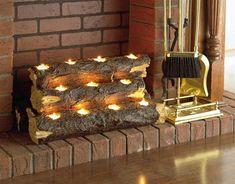 ungenutzter kamin wohnzimmer holzklotz teelichter ziegel