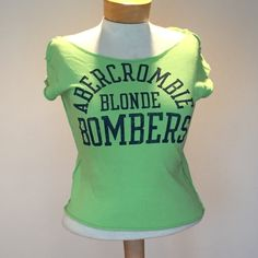 "New without tags A&F Blonde Bombers TShirt New without tags A&F Blonde Bombers TShirt. Size says large but 16 1/2"" under the arms and 19"" long. Cotton.  Precut at neck and arms and bottom by A&F. Abercrombie & Fitch Tops Tees - Short Sleeve"