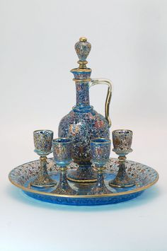 Moser glass decanter set comprised of ewer with stopper, four liqueur glasses and circular tray - Light blue glass with overall polychrome and gilt scroll enameling and gilt trim.-From the Estate of Bern Sharfman, Harrisburg, PA. - Ewer with stopper - H Liqueur Glasses, Bohemia Glass, Antique Glass, Antique Toys, Glass Ceramic, Carnival Glass, Vases, Decanter, Glass Pitchers