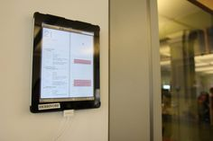 iPads hang on the walls displaying the company Google calendar, giving employees the ability to take it down and use it for video chats.