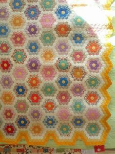 Notice how the quilt edge was finished for this Grandmother's Flower Garden