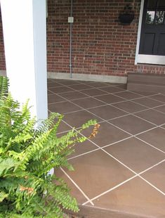 Or, make faux tiles with concrete stain. | 39 Budget Curb Appeal Ideas That Will Totally Change Your Home