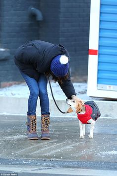 A caring Meghan even gave her hound his very own coat to ensure that he was warm ...