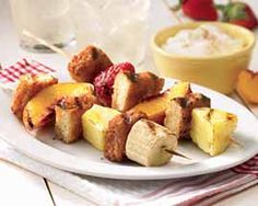 Grilled FrenchToast and Fruit Skewer with Yogurt Recipe - Apple cinnamon flavors hot off the grill! Crisp toast sticks are simply skeweredwith fruit and grilled. A true treat dipped into refreshing vanilla flavored yogurt. #Schwans #EasyRecipes #Inspiration