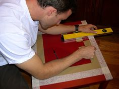 """Checkerboard Game Table - Home Stories A to Z. """"used packing tape which is a perfect 2 inches wide. He marked off the borders, doubled up the packing tape, and then cut out 2 inch squares with an exacto knife. He then just made a checkerboard with the packing tape. I spray painted it """""""