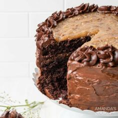 This gorgeous tiered German chocolate cake is swoon-worthy. Coconut pecan filling provides a delicate crunch between layers of moist cake. This impressive homemade German chocolate cake has tall decadent layers of moist chocolate cake, coconut-pecan filling, and chocolate frosting. This gorgeous 3-tiered German chocolate cake is swoon-worthy. Coconut pecan filling provides a delicate crunch between layers of chocolate cake. Traditionally, this cake is slathered with coconut pecan frosting, but t