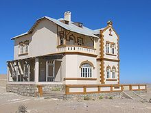 Kolmanskop (Afrikaans for Coleman's hill, German: Kolmannskuppe) is a ghost town in the Namib desert in southern Namibia