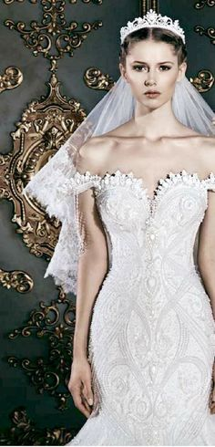 I am loving this whole look...the short wide lace edged veil and the Tiara is gorgeous...MICHAEL CINCO V