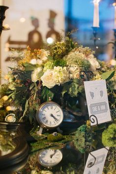 green and white centerpiece with clocks and silhouettes by Platinum 7 Dezines. Photo by Josh McCullock Photo & Films.