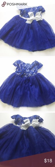 Royal Blue Formal Dress Sz 12 Months Formal Special Occasion Dress. Adorable blue sparkly dress. Top is silver with blue lace overlay, with sequins for sparkle. Bottom is tutu style with sparkles. Gorgeous dress. Silver bow in front has a little fraying but overall excellent condition. Size 12 months Dresses Formal