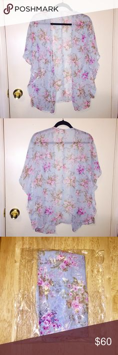 NWOT Beautiful Sky Blue Floral Silky Sheer Kimono New, never worn, I just have too many of these beautiful pieces. So silky and nice to wear, the Floral design is beautiful~ Buy 2 pieces from my closet and receive a free surprise gift with your purchase ❤️ Closet clearout, feel free to send me reasonable offers on any of my listings, everything is negotiable :) Sweaters Cardigans