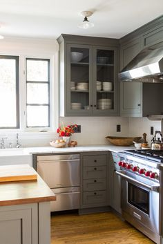 Classic Shaker style cabinets painted in Benjamin Moore Amherst Gray, mixed with contemporary details