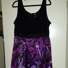 Sleeveless satiny dress Gorgeous and super comfortable. Has a belted look that hits at the waist. Fits true to size. Loved this dress, sad it no longer fits! Lane Bryant Dresses