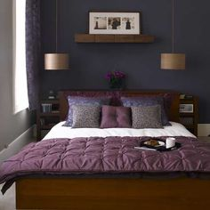 Shelf above bed, purple throw white bedcover.
