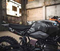 This is undoubtedly one of the coolest BMW R Ninet conversions out there. Now christened Thor, this amazing blacked-out and carbon-fiber clad scrambler was built by the Injustice Customs workshop located in the heart of Gothenburg, Sweden. Ninja Motorcycle, Bobber Motorcycle, Bmw Motorcycles, Motorcycle Tips, Motorcycle Quotes, Cargo Bike, Moto Bike, Nine T Bmw, Custom Street Bikes
