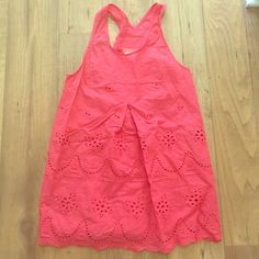 Coral flowy tank top Coral tank top. Racer back style back. See through patterned details. Brand new, never worn. Tops Tank Tops