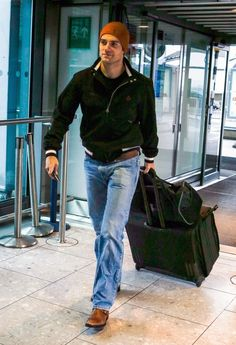 Henry Cavill arriving to catch a flight at Heathrow airport