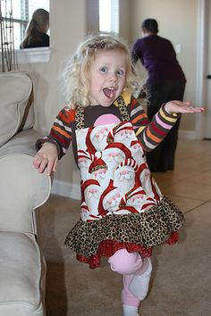 The Christmas apron I made for my granddaughter...gotta love a Santa who wears leopard print!