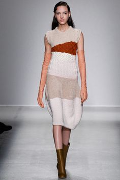 Subtle knit manipulation with different textures and weaves including varying creamy hues and a hit of seasonal burnt sienna.  Christian Wijnants Fall 2014 Ready-to-Wear Collection Slideshow on Style.com