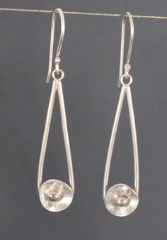 Long slender silver earrings with a by QuietTimeJewelry on Etsy, $35.00