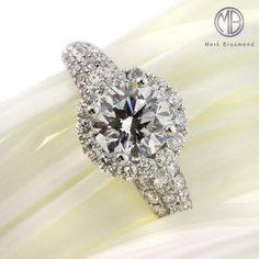 This spectacularly beautiful round brilliant cut diamond engagement ring has an awesome combination of quality and design at a great value! It features a gorgeous 1.04ct round cut diamond in the center. It is GIA certified (one of the leaders in diamond grading) at G-SI2, perfectly white and eye clean!