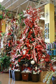 Red and white candy cane themed Christmas tree