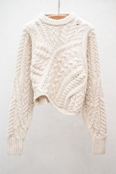 This winter, chunky knits - Isabel Marant -- This would be a fun knit.  Just start knitting strips of cable and sculpt the sweater with a C bust and the V taper which fits me best.
