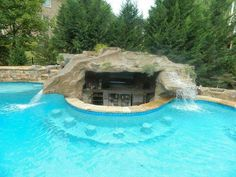 Did You say Give Me a Pool that has it All? Ok, here it is — A Pool With Slide… Did You say Give Me a Pool that has it All? Ok, here it is — A Pool With Slide, Waterfall Grotto AND Swim Up Bar! Luxury Swimming Pools, Luxury Pools, Dream Pools, Swimming Pools Backyard, Swimming Pool Designs, Pool Landscaping, Amazing Swimming Pools, Piscina Rectangular, Rectangular Pool