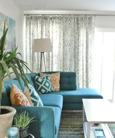 Centstational Girl adds beautiful wave drapery to her living room.