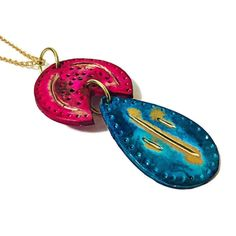 This stunning bohemian style pendant was handmade from polymer clay and painted with alcohol ink. It features a vibrant mix of turquoise, pink and gold and comes on a nickel free gold tone chain.  The pendant measure 3 inches long and 1.5 inches wide. You can choose your preferred length of necklace. #bohopendant #largependant #polymerclayjewelry