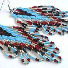 Native American Inspired Looped Fringe Bugle Bead Earrings. These earrings are hand stitched by me bead by bead, one-bead-at-a-time. They are created in a brick or Cheyenne stitch style. They are made with uniform seed beads, bugle beads and faceted glass beads. Colors: red, orange, yellow, black, silver, turquoise blue. Earrings: 7/8 inches wide and 4 inches long (not including the surgical steel ear hook). Please be sure to check out my Boutique for different colors, styles or leng...