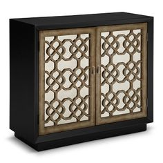 Moor and More. Moorish decorations meet modern furniture design in the Amelie door chest. Frosted door frames and latticework in a traditional Moorish pattern overlay the antiqued mirror-front doors for a far-off effect. This piece is also practical, as it features a large, adjustable shelf on the interior, providing plenty of storage options. The tassel motif drop-pendant nickel hardware, black wood body and recessed base complete the modern look.