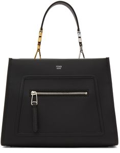Structured buffed calfskin tote in black. Detachable carry handle at top featuring signature logo hardware and lanyard clasp fastening. Detachable and adjustable shoulder strap with post-stud fastening. Zippered pocket featuring canvas lining in black and logo stamp in silver-tone at face. Bumper studs at base. Magnetic fastening at throat. Price: $1990  #nosafashions #fendi #blacktote #totebag #blacktotebag #smalltote #smallbalcktotebag Logo Stamp, Black Tote Bag, Running Away, Signature Logo, Hermes Kelly, Fendi, Shoulder Strap, Stuff To Buy, Bags