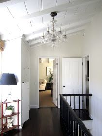 classic • casual • home: California French Cottage Home Tour | Here, in the upstairs hall you get the beach cottage feel but with the elegance of a crystal chandelier.