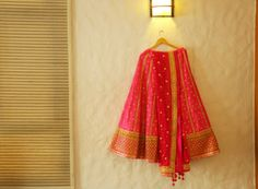 Bridal Lehengas - Pink and gold lehenga | WedMeGood Bright Pink Lehenga with gold gota patti work, gold thick border and pink dupatta #wedmegood #lehenga #gotapatti #pink