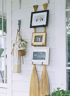 Enlist two retired wooden canoe paddles as the support act for a trio of picture frames. Screw metal hooks into each paddle to create mini ledges for the frames to rest on. For frames in harmony with the backup crew, select ones with scratches and dents.