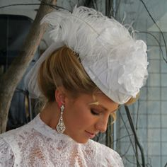 White crushed velvet teardrop hat with fabric flower, wide gros-grain ribbon, ostrich, and English netting.