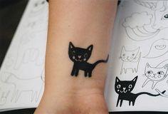 Image via We Heart It https://weheartit.com/entry/65631573/via/1283697 #animal #black #cat #cute #hands #kitty #tattoo #gattino