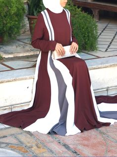 Springing to life when you walk, twirl or spin, the Vibrant Abaya is a very unique kind of vibrant. Exposed only in its entirety by movement, folds of color run down the sides of the silhouette of this piece that make for a vibrancy that isn't flashy. Wear for special or formal occasions - this abaya is definitely a show stopper! Abaya Fashion, Fashion Wear, Fashion Outfits, Mode Abaya, Mode Hijab, Modest Outfits, Girl Outfits, Fashion Essay, Hijab Style Dress