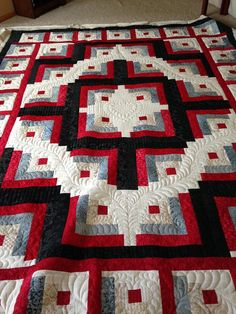 This log cabin quilt was a wedding gift for Teresa's daughter and her fiancé. Can you believe this is the first large piece she custom quilted?? Fantastic job, Teresa!