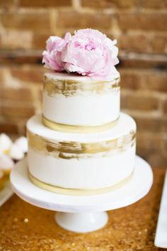 White cake with gold painted edges and fresh pink peonies! Magnolia Photography