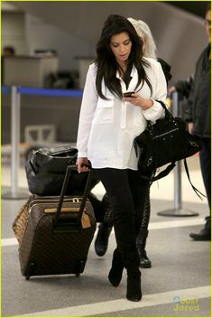 965760597590 Kim Kardashian  Pregnant in Heels at LAX Airport!  Photo Kim Kardashian  flashes a big smile while wheeling her luggage through LAX Airport on  Monday ...